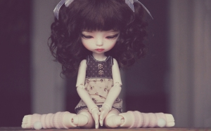 sad-doll-sitting